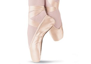 An image of ballet shoes on feet