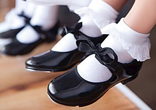 An image of tap shoes on feet